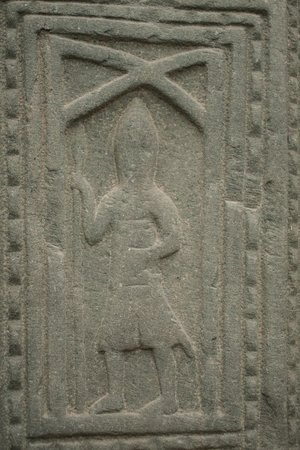 church grave slab of a kilted warrior